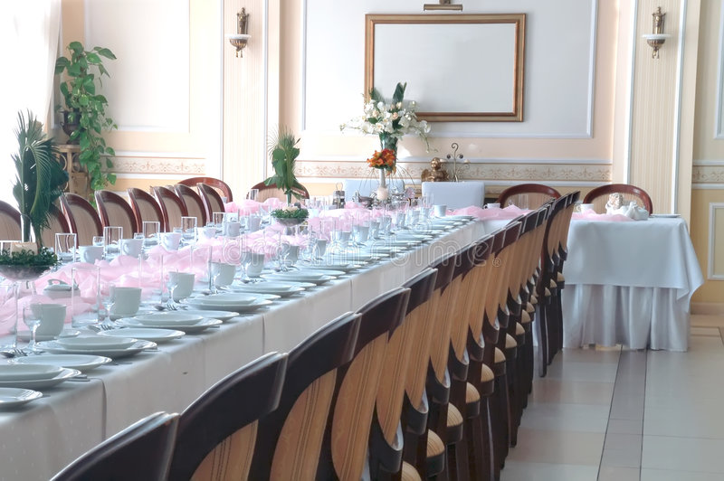 Presidential chairs by table. Presidential chairs by long pink banquet table royalty free stock photos
