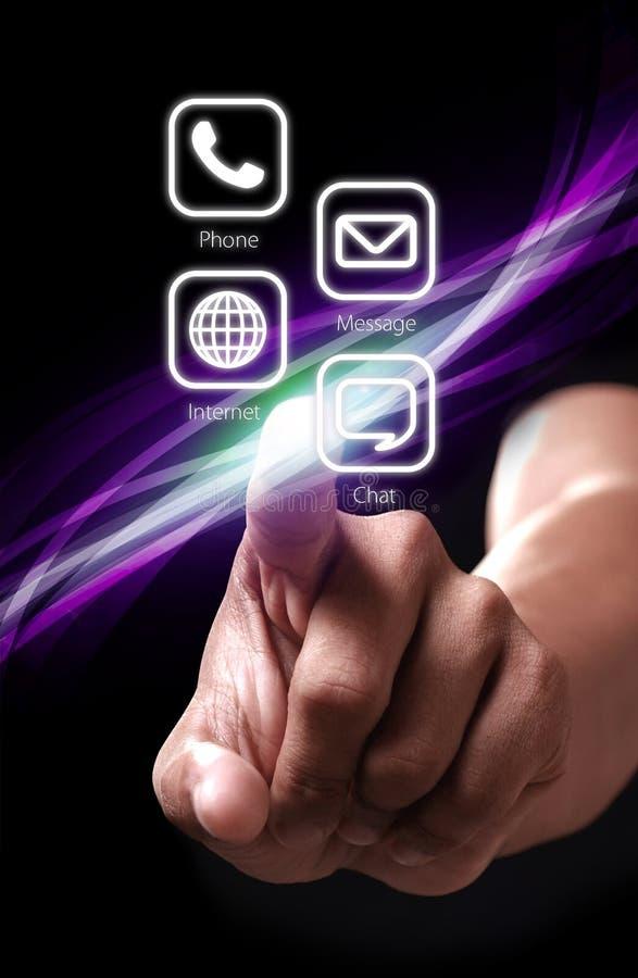 Presionado a mano el botón blanco de los apps del color foto de archivo
