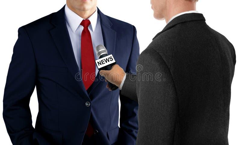 Presione la entrevista con el hombre de negocios fotos de archivo