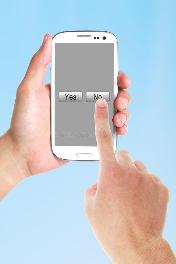 Presione no en el teléfono celular imagenes de archivo
