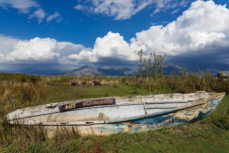 Prespes lakes, Greece. Traditional wooden boat with paintings at the Prespes lakes, Greece on September 26, 2017 royalty free stock photography