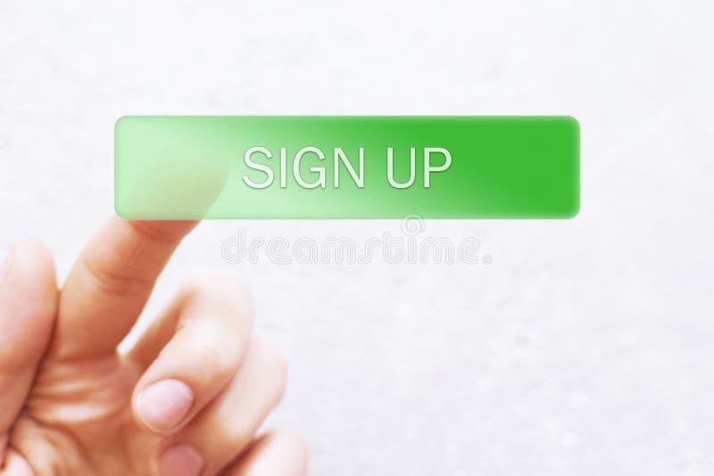 A pressão do dedo verde assina acima o botão imagens de stock royalty free
