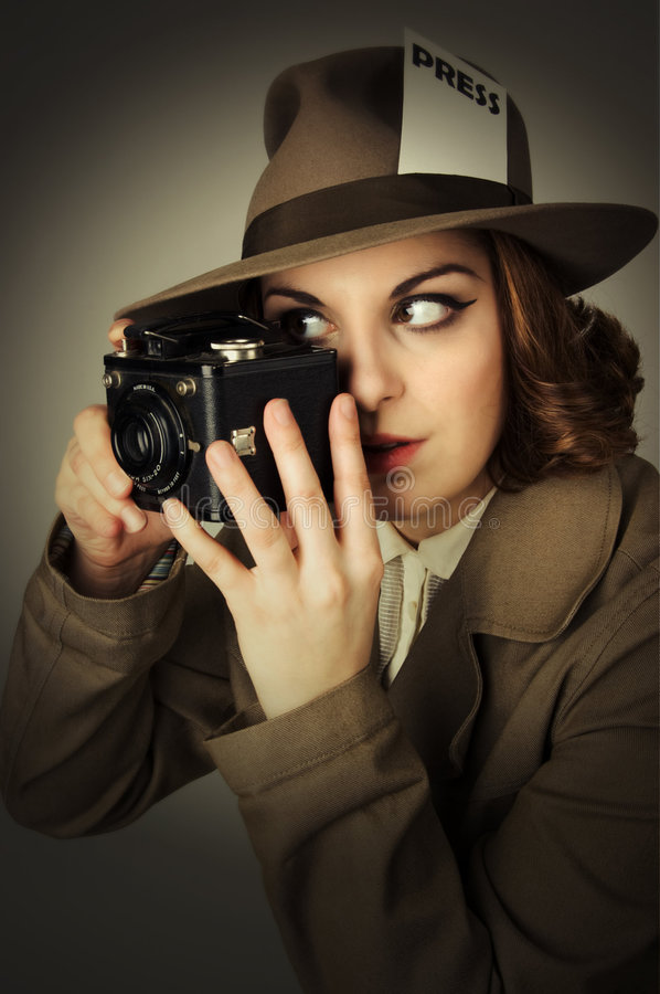 The Press. Recreation of a 1940's press girl taking a picture with a vintage camera royalty free stock photography