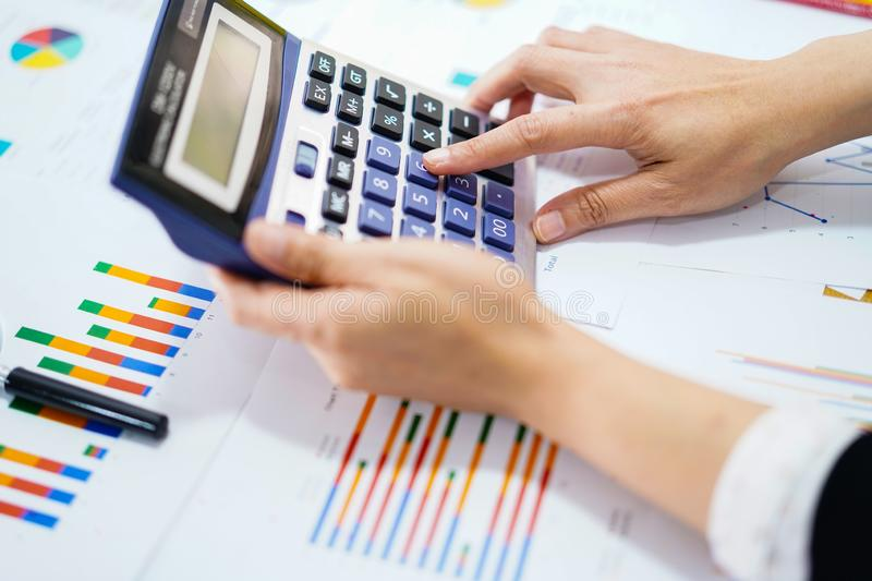 Press calculator on chart and graph paper. Finance development, Banking Account, Statistics, Investment Analytic research data. Press calculator on chart and royalty free stock photos