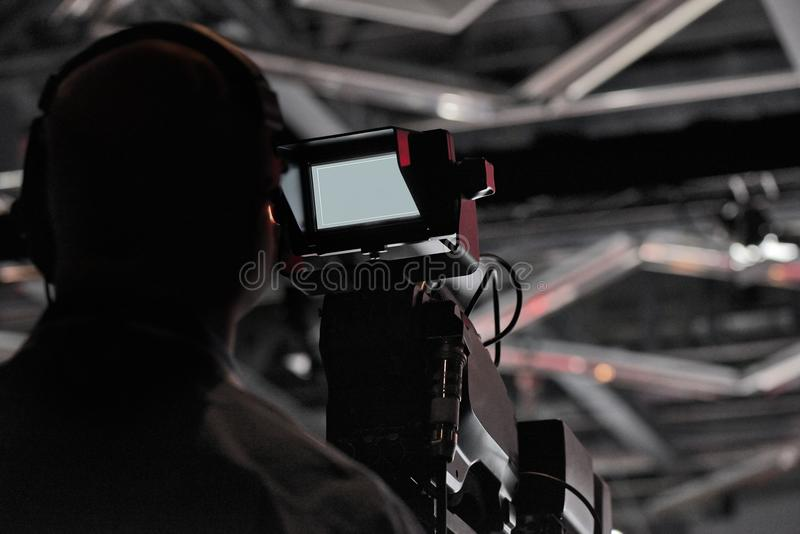 Press Conference production cameraman silhouette. Television Press Conference production cameraman silhouette royalty free stock photo