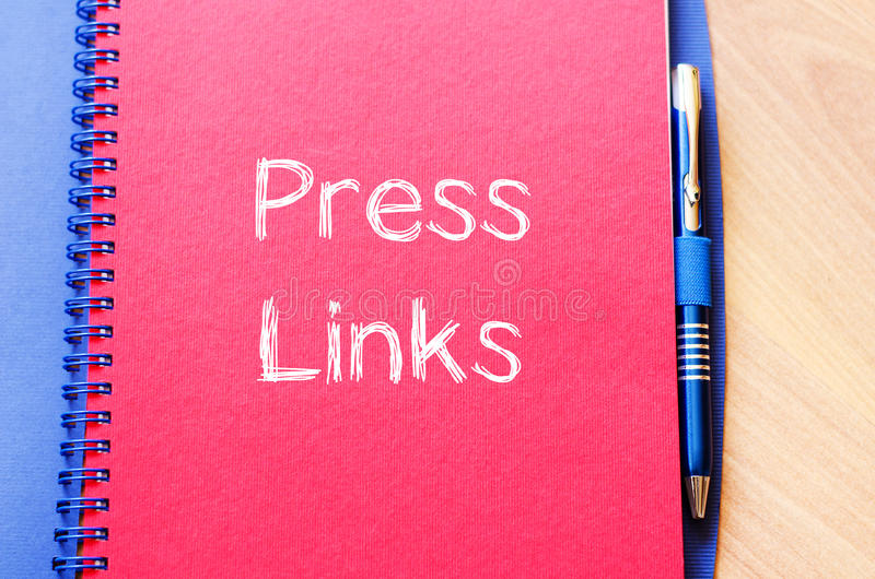 Press links concept on notebook. Press links text concept write on notebook stock photos