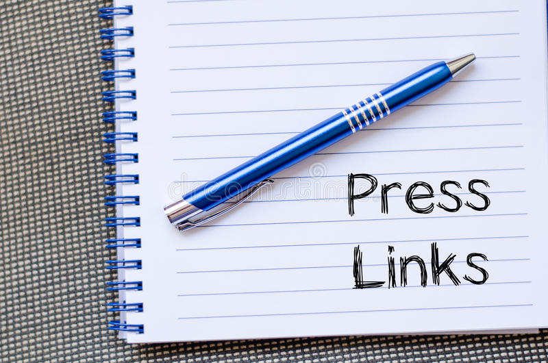 Press links concept on notebook. Press links text concept write on notebook stock image