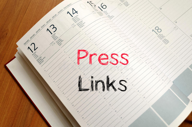 Press links concept on notebook. Press links text concept write on notebook royalty free stock photo