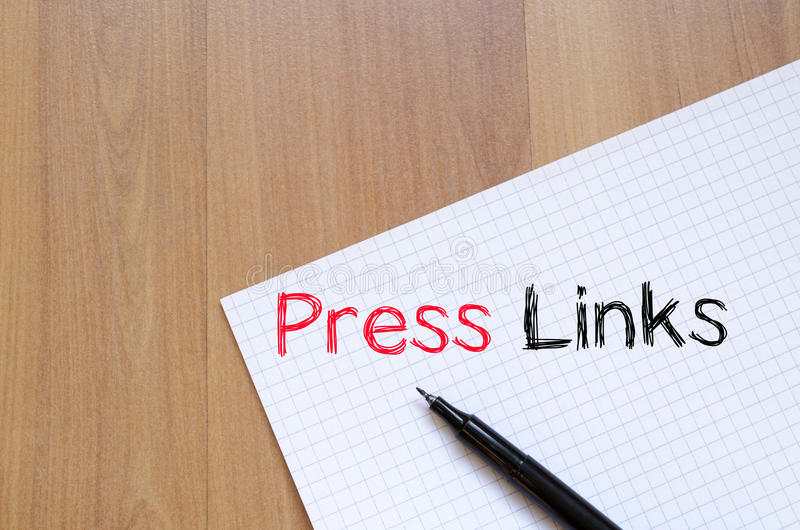 Press links concept on notebook. Press links text concept write on notebook stock images