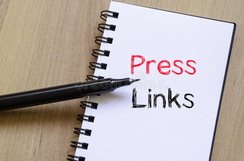 Press links concept on notebook. Press links text concept write on notebook royalty free stock image