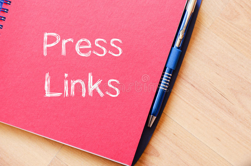 Press links concept on notebook. Press links text concept write on notebook royalty free stock photos