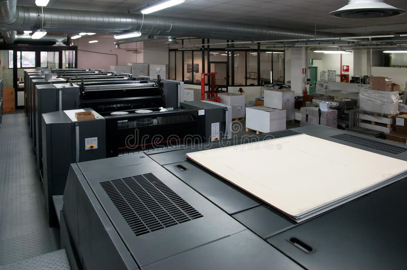 Press printing - Offset machine. Offset press is a printing machine designed to produce fine quality reproductions. Offset printing is a widely used printing stock photo
