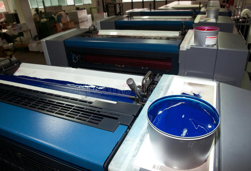 Press printing - Offset machine (detail Ink). Offset press is a printing machine designed to produce fine quality reproductions. Offset printing is a widely used stock image
