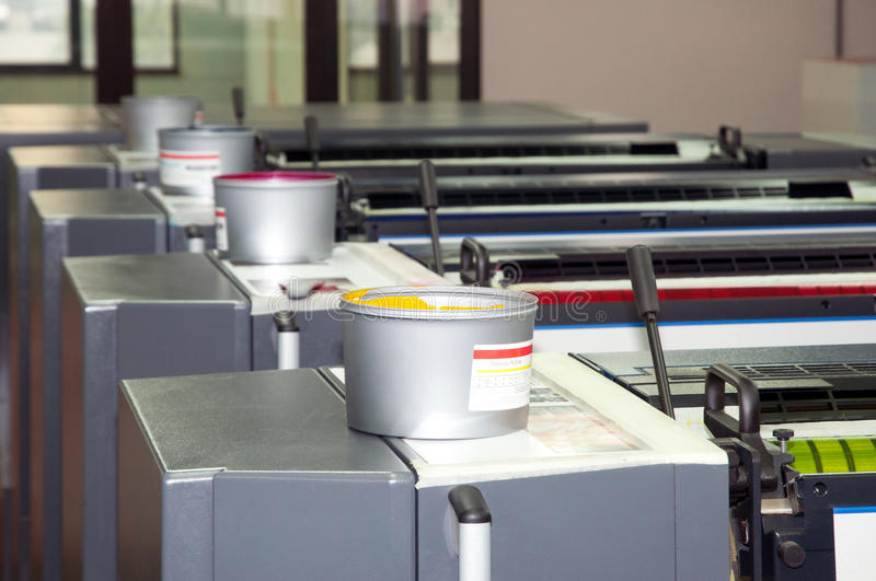Press printing - Offset machine (detail Ink). Offset press is a printing machine designed to produce fine quality reproductions. Offset printing is a widely used stock photos