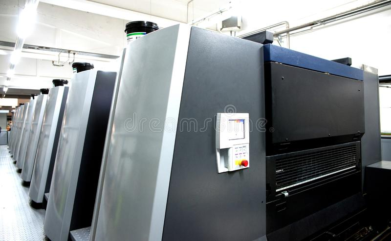 Press printing - Offset machine. Printing technique where the inked image is transferred from a plate to a rubber blanket, then to royalty free stock images