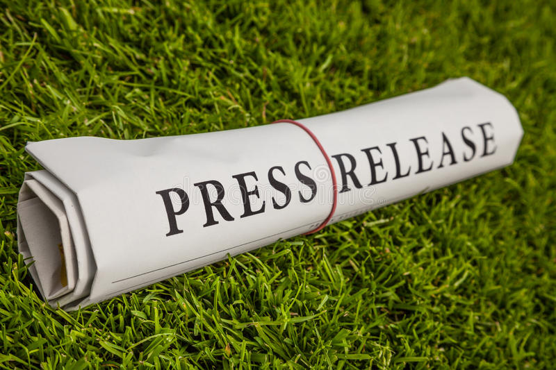 Press release. On green meadow royalty free stock photography