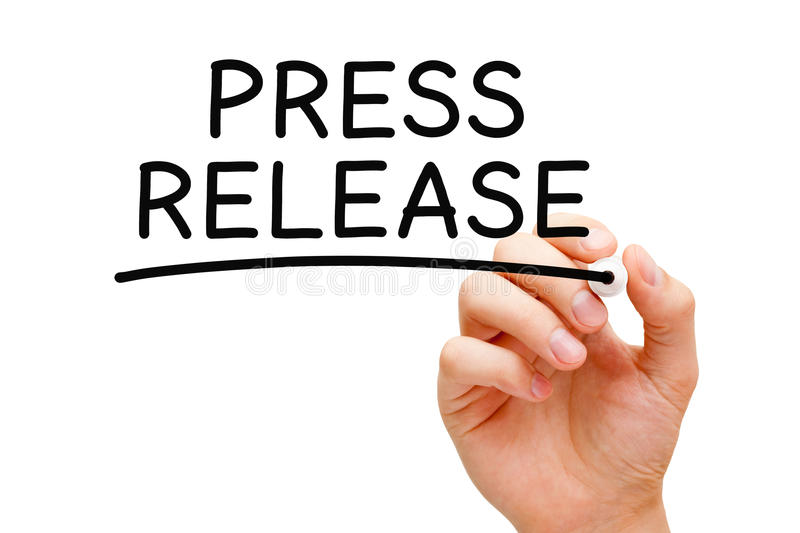 Press Release. Hand writing Press Release with black marker on transparent wipe board on white royalty free stock photo