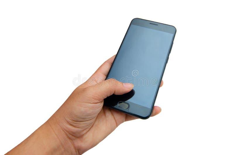 Pressande svart telefon för handtelefonisolat hand på en vit bakgrundsisolat arkivfoto