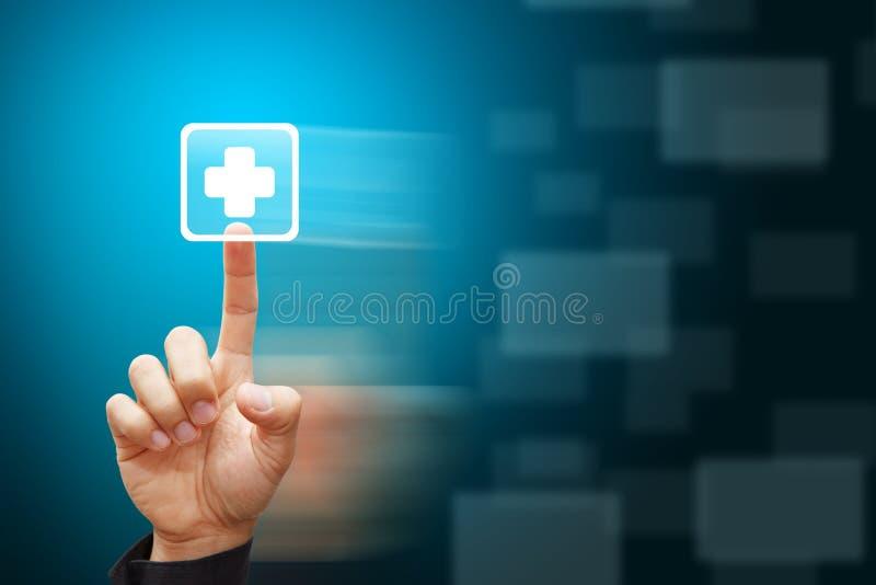 Presse intelligente de main sur le signe de premiers soins photos stock