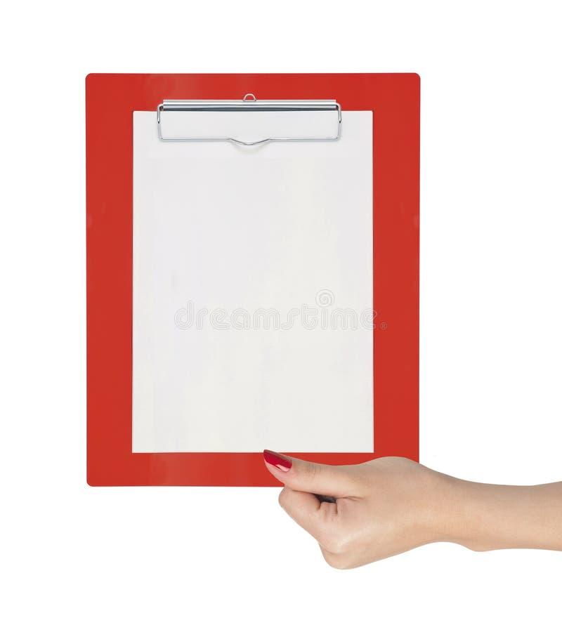 Presse-papiers avec le papier blanc chez la main de la femme photos stock