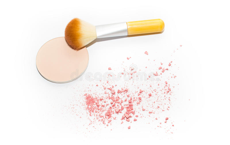 Pressed beige powder, make up brush and pink blush on white isolated background stock images