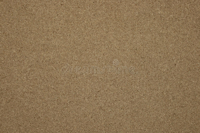 Pressed chipboard texture. Wooden background royalty free stock photos
