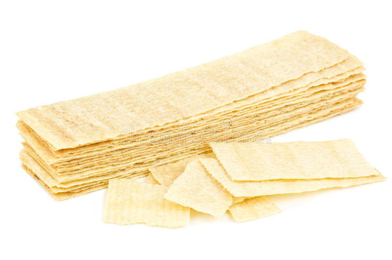 Pressed chips. Pressed crunchy chips on white stock photos