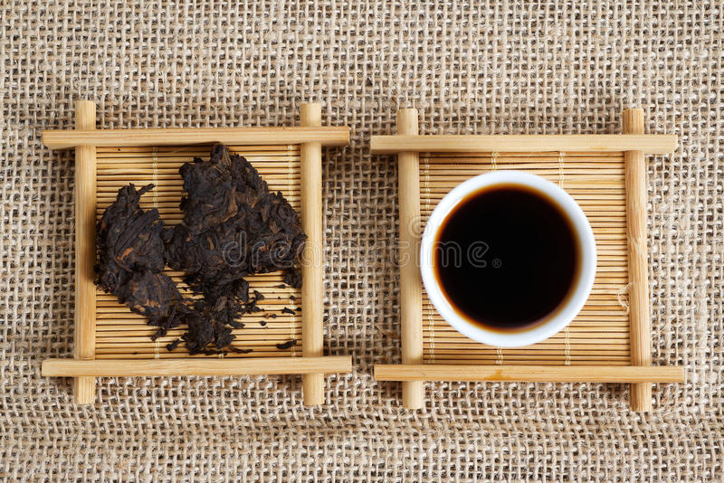 Pressed pieces Puer tea. Pieces Chinese Puer tea and cup. Yunnan province China royalty free stock photos