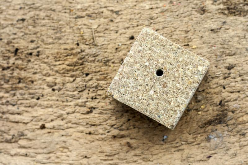 Pressed soybeans in a briquette. It is used as feed for animals, birds and fish. One of the feed ingredients royalty free stock photo