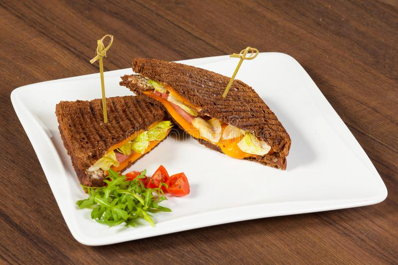 Pressed and toasted double panini with ham and cheese served on sandwich royalty free stock photography