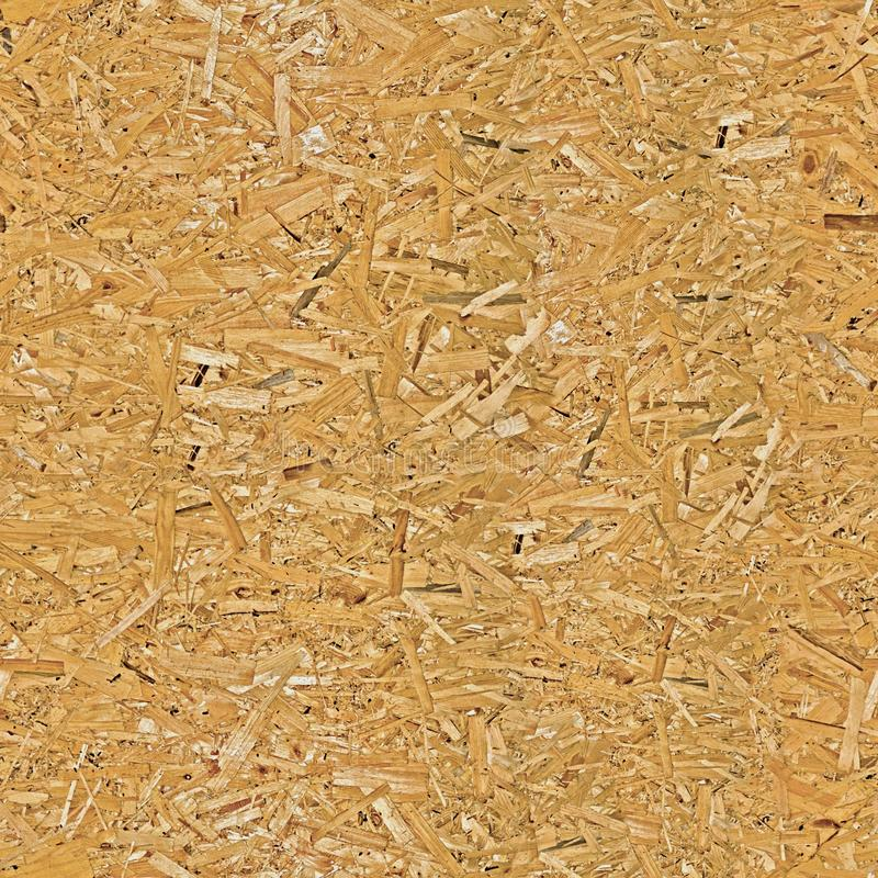 Pressed wood chipboard texture. Seamless pattern. Pressed wood chipboard texture. Seamless pattern stock image