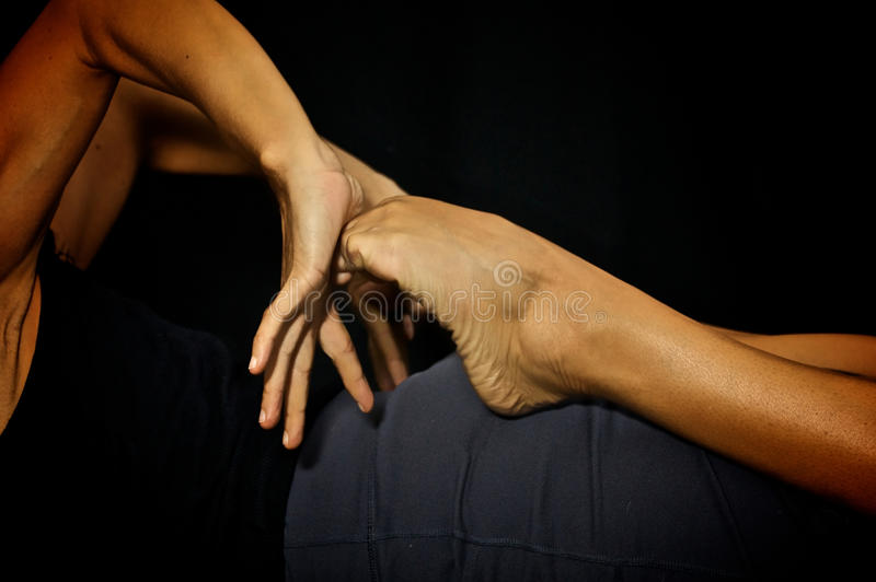 Pressing palms into toes