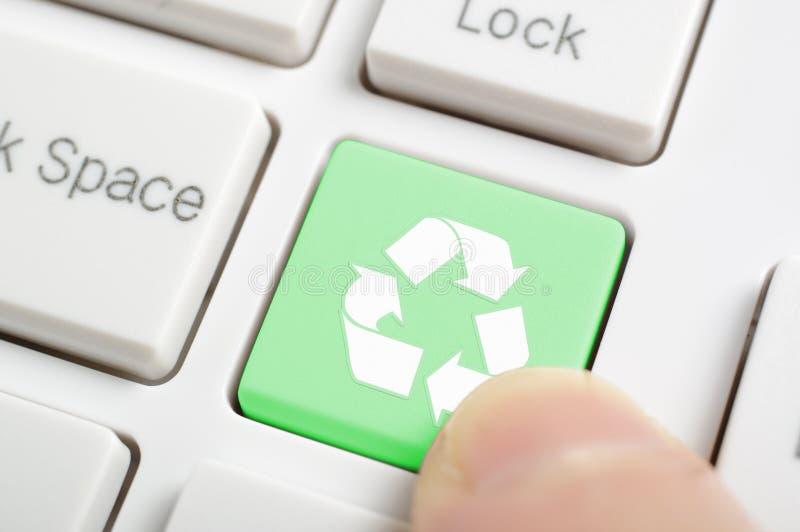 Pressing recycle symbol key stock photos