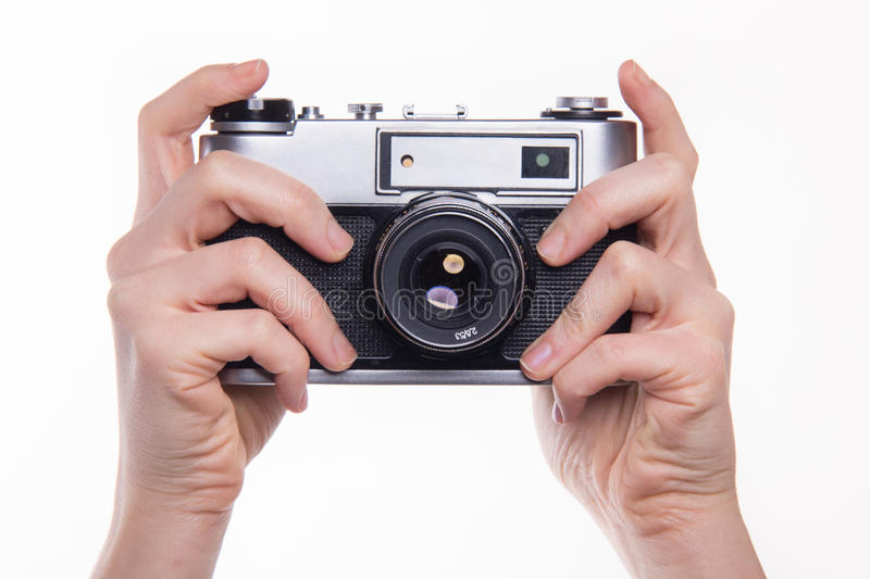 Pressing shutter in 35mm classic photo camera. Classic 35mm old analog camera on white - studio shoot stock photography