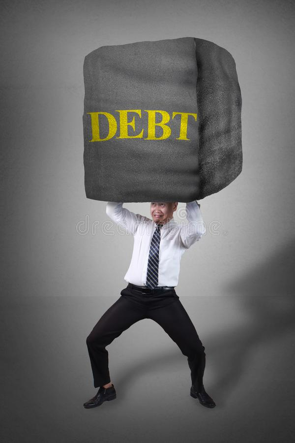 Pression d'Under Big Debt d'homme d'affaires image libre de droits