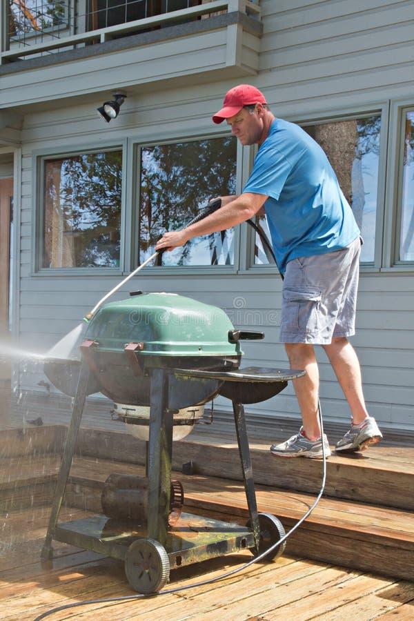 Pression lavant le barbecue extérieur photo libre de droits