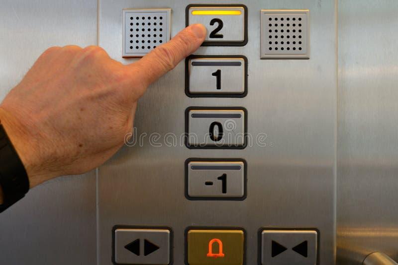 Pressiona o botão do elevador imagens de stock royalty free