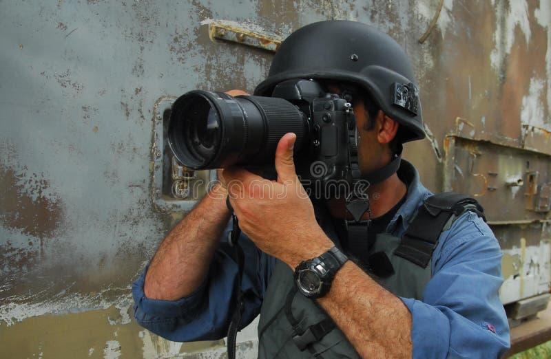 Pressione o fotógrafo do jornalista fotográfico foto de stock