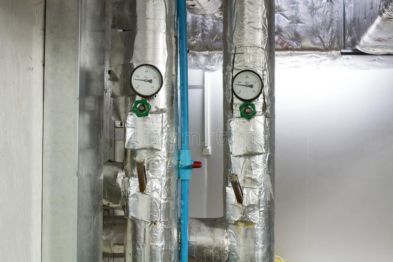 The pressure analog gage in water cold pipe on air condition system royalty free stock images