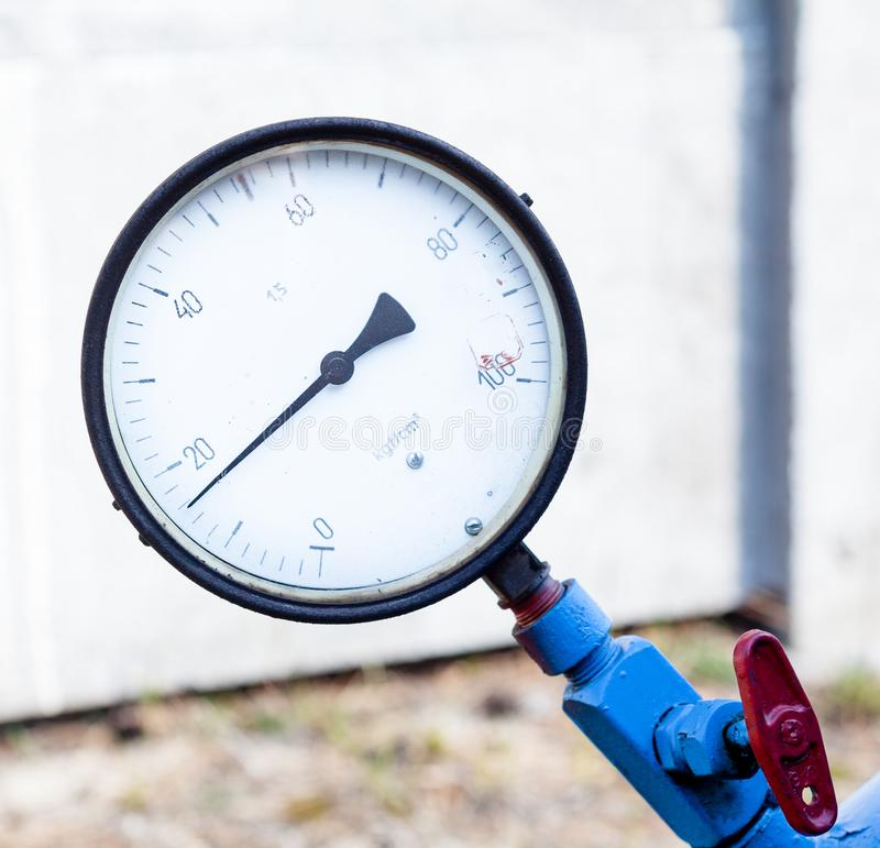 Pressure gauge on the blue pipe royalty free stock images