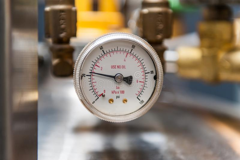 Pressure gauge  on blurred background royalty free stock photography