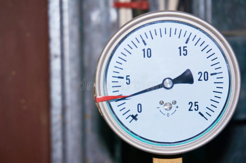 The pressure gauge indicates the pressure in the pipeline. Close-up stock image
