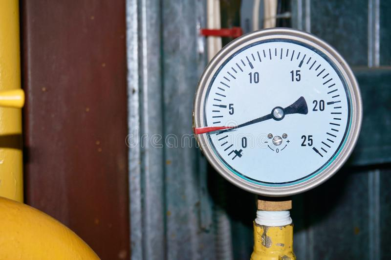 The pressure gauge indicates the pressure in the pipeline. Close-up royalty free stock photography