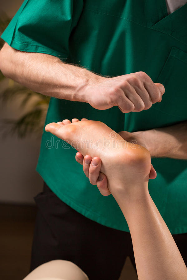 Pressure points on foot. Theraphy based on kneading pressure points on feet royalty free stock photography