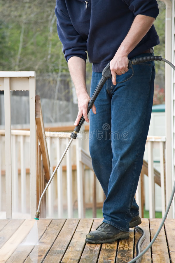 Pressure washing the deck royalty free stock image