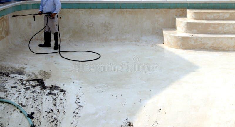 Pressure washing pool stock photo