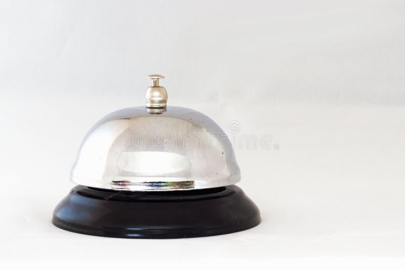 Preste serviços de manutenção a Bell no fundo branco foto de stock royalty free