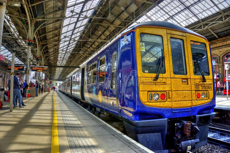 Preston Railway Station In North West England. Preston, United Kingdom - May 14, 2019: Preston railway station In north west England with train at platform and stock photography