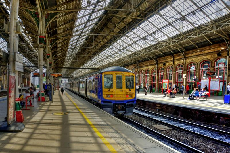 Preston Railway Station In North West England. Preston, United Kingdom - May 14, 2019: Preston railway station In north west England with train at platform and royalty free stock photography