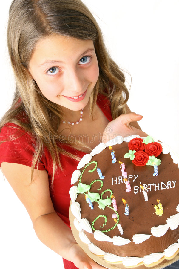 Preteen with birthday cake. Young girl with a chocolate birthday cake royalty free stock images